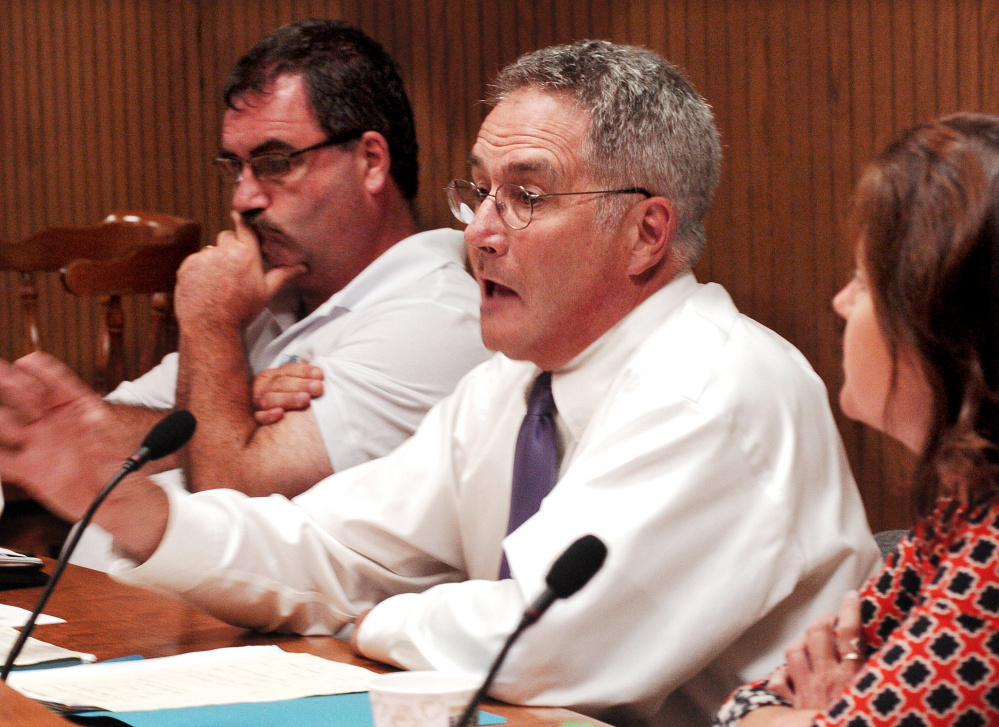 Waterville City Councilor Chairman John O'Donnell, center, makes a motion during a heated discussion of the municipal and school budgets on Tuesday. O'Donnell is flanked by councilors Sydney Mayhew, left, and Dana Bushee.