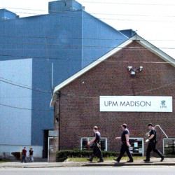 Workers carry tools into the Madison Paper Industries mill in Madison on May 23, two days after the mill ended production.