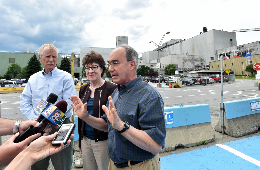 Sen. Angus King, left, Sen. Susan Collins, middle, and Rep. Bruce Poliquin, right, speak to reporters July 1 after a tour of Sappi Fine Paper in Skowhegan. The trio requested the deployment of a federal team that's in Maine this week gathering information on the challenges and assets of the state's forest products industry.