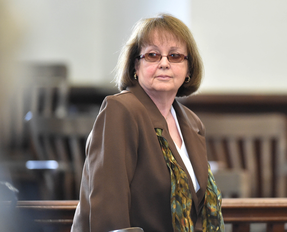 Claudia Viles stands as the jury leaves the court room to deliberate on the 13 charges against her at Somerset County Superior Court in Skowhegan on June 22. Anson's excise tax collections, which directly fund the town's highway department budget, have soared in the year since she resigned as the tax collector and the property tax rate has gone down.