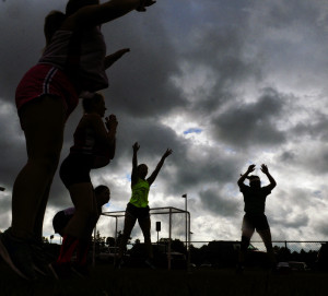 Members of the Cony field hockey team exercise during practice on Wednesday at Cony High in Augusta.