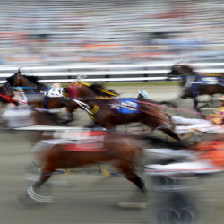 Harness racers leave the gate for the annual Walter H. Hight Memorial Pace at the Skowhegan Fair Grounds in Skowhegan on Saturday.