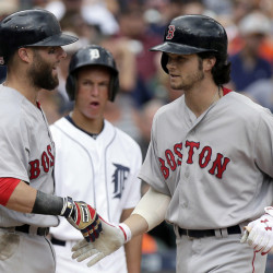 Boston's Andrew Benintendi, right, is congratulated by Dustin Pedroia after hitting a two-run home run against the Detroit Tigers during the seventh inning Sunday in Detroit.