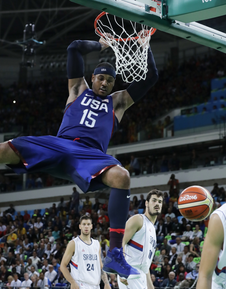United States' Carmelo Anthony dunks against Serbia during the men's gold medal basketball game at the 2016 Summer Olympics on Sunday in Rio de Janeiro, Brazil.