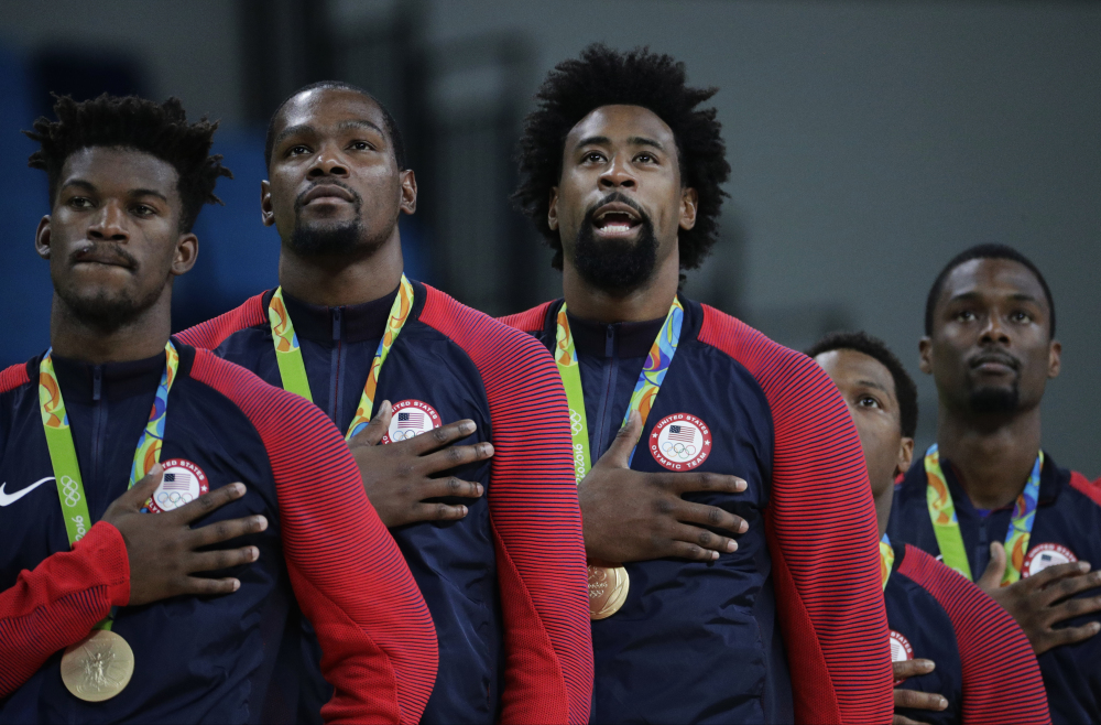 Members of the United States' basketball team stand for the national anthem after accepting their gold medals at the the 2016 Summer Olympics on Sunday in Rio de Janeiro, Brazil.