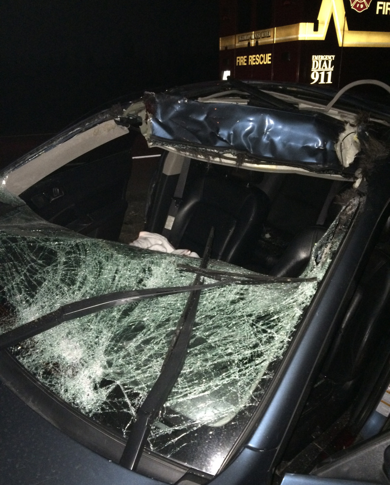 A Subaru Legacy driven by  John Coyle shows the damage after he hit a moose on U.S. Route 201 Saturday night. Coyle was in critical condition at Central Maine Medical Center in Lewiston Monday.