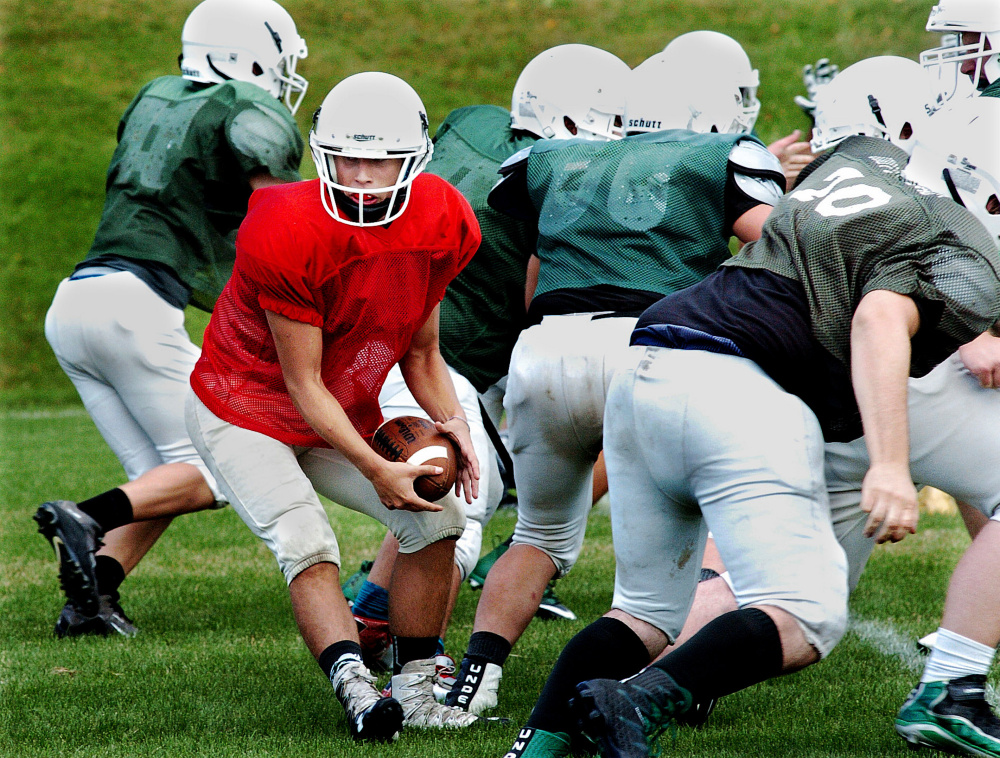 Mount View quarterback Rayno Boivin looks to hand off the ball during a scrimmage in Pittsfield on Monday.