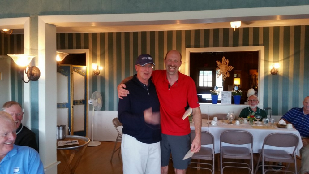 Men's Division A — 1st place winners were Jim Jannace, right,   (not shown Jeff Slinn, Mike Spear and Doug Osgood)m, with Master of Ceremony Rick Walker, left.