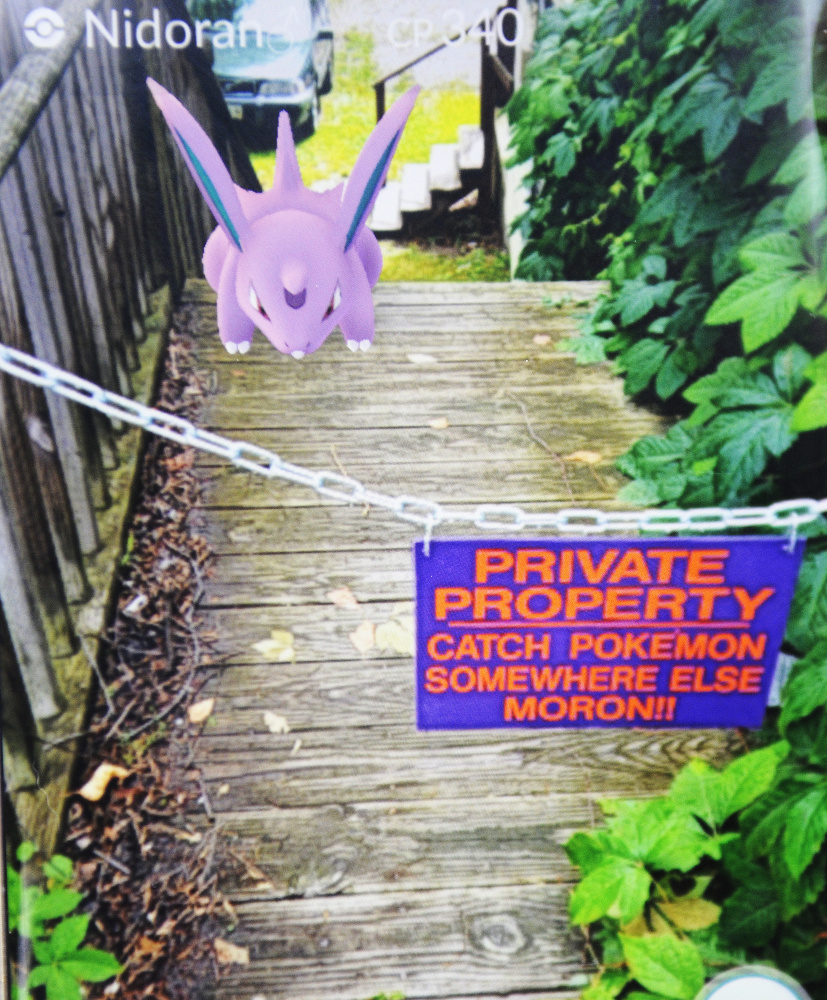A screenshot from Pokémon Go with a virtual character Nidoran located on a stairwell that is posted with a no trespassing sign in Hallowell.