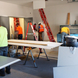 Workers from several companies work inside the sally port garage Tuesday in the new Oakland police building.