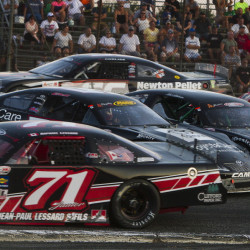 Cars get spun around on the first corner of the track early in the Oxford 250 last August at Oxford Plains Speedway.