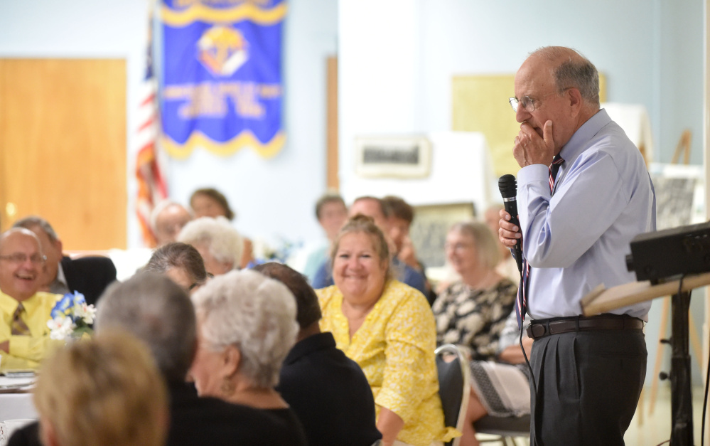 Staff photo by Michael G. Seamans16 Former U.S. Sen. George Mitchell, right, pauses for a moment as he speaks during an endowment fund dinner at his childhood church, St. Joseph's Maronite Church, in Waterville on Wednesday.