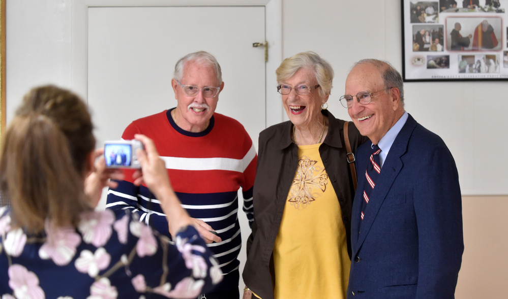 Former U.S. Sen. George Mitchell takes a moment to have a photo with Ray and Lorraine Cyr at St. Joseph's Maronite Church in Waterville on Wednesday.