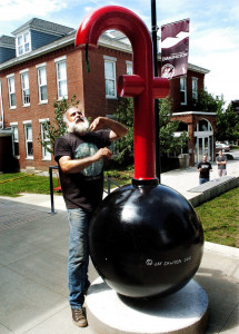 "Sculptor Jay Sawyer finishes setting up his sculpture ""F Bomb"" on Thursday as part of an exhibit at the Emery Community Arts Center at the University of Maine in Farmington."