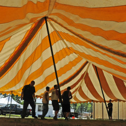 Maine Bay Canvas workers raise a tent Wednesday at the Windsor Fairgrounds. The fair runs from Sunday to Sept. 5.