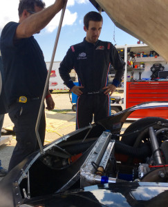 Fort Kent native Austin Theriault, right, looks over his car during a break in a Oxford 250 practice on Friday afternoon in Oxford. Theriault has two career podium finishes in the 250.