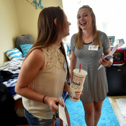 First-year students Makenzie Carlow, left, and roommate Taylor Peno laugh as they move into their Hinman Hall dormitory room Friday at Thomas College in Waterville. Freshmen moved in Friday and classes begin Monday.