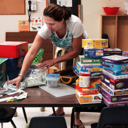 North Elementary School kindergarten teacher Gina Davis unpacks supplies for the school year Thursday in Skowhegan.