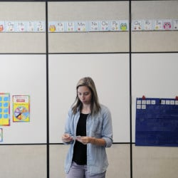Samantha Jordan arranges a mathematics display in her classroom last week at Helen Thompson School in West Gardiner. In her first classroom and teaching first grade, Jordan's first day of school is Wednesday.