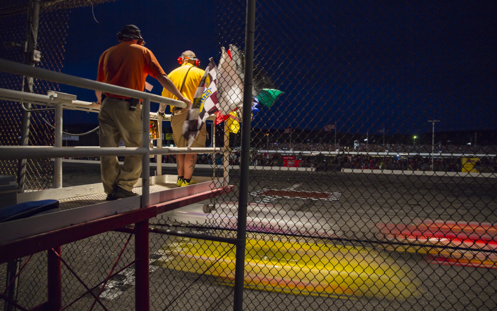 Race officials stand on a platform at the finish line during the Oxford 250.