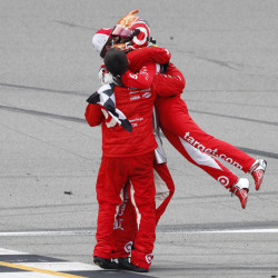 Kyle Larson celebrates with crew members after winning the NASCAR Sprint Cup Series race Sunday at Michigan International Speedway in Brooklyn, Michigan.
