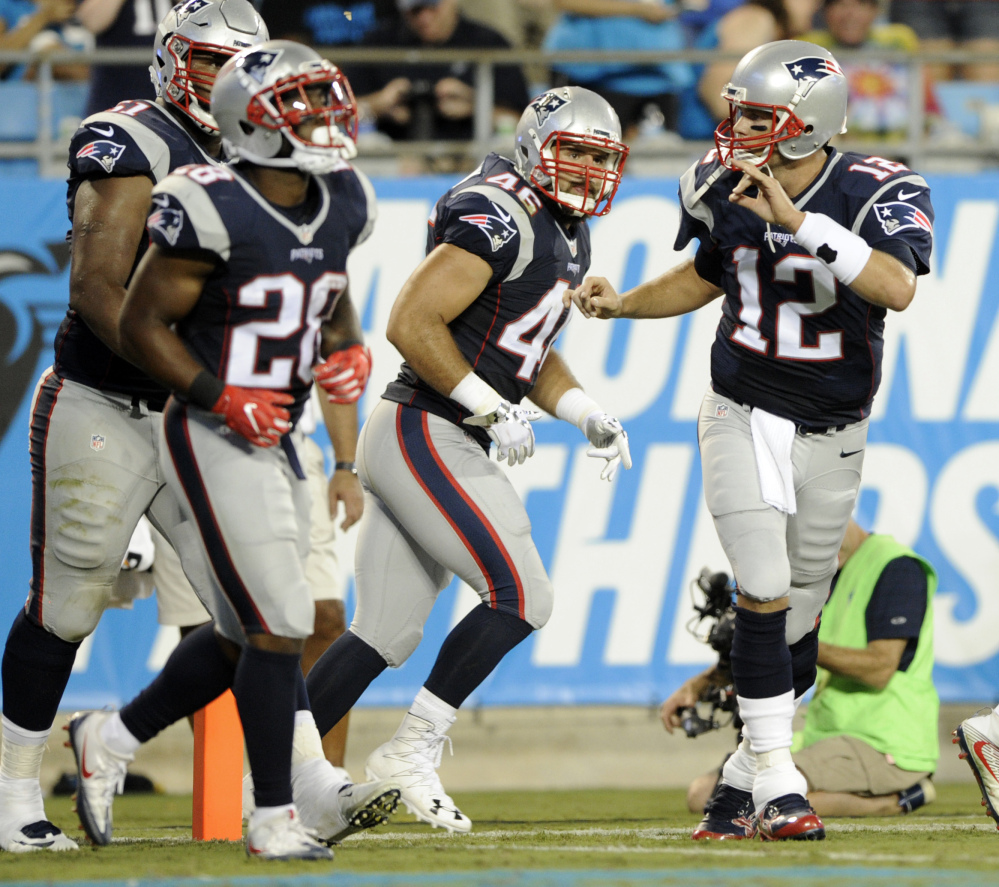 New England Patriots quarterback Tom Brady (12) reacts after his touchdown pass against the Carolina Panthers during the first half of a preseason game Friday in Charlotte, North Carolina.
