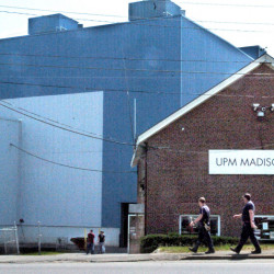 Mill workers carry tools into the Madison Paper Industries mill in Madison on May 23. The mill's closure, announced in mid-March, has impacted the town's tax rate,