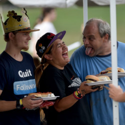Andrew Zelonis, far right, offers some comic relief to his friends and Waterville adult education students Ashley Varner, center, and Brendon Chalmers, far left, as they get their food on Tuesday during the yearly Waterville Senior High School open house barbecue at Head of Falls in Waterville.