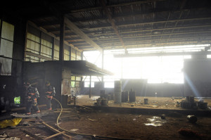 Gardiner firefighters extinguish a blaze Monday inside the former T.W. Dick Co. iron works on Summer Street in Gardiner.