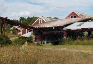 This former deteriorated sawmill in Vassalboro at the Masse Dam is expected to be torn down so water pipes below it will not be damaged and cut off water supplies when the dam is removed as part of the Alewife Restoration Initiative.