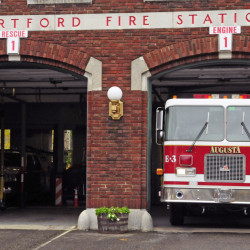Augusta firefighter/paramedic Kevin Curry touches a wall from the drivers side window to show how narrow the space is as he moves Engine 3 to another bay in October 2014 at Hartford Station in Augusta. The City Council on Thursday will consider whether to ask voters to approve borrowing money to expand the station.