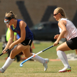 Messalonskee High School's Autumn Littlefield moves the ball the past Gardiner Area High School's Jazmin Cleary during a field hockey scrimmage in Winslow on Saturday.