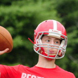 Cony quarterback Taylor Heath winds up to pass during an Aug. 16 practice at Cony High in Augusta.