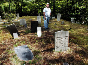 Peter Fotter talks about the town-owned Tuttle Cemetery in Rome, which is accessible by traveling down Fotter's driveway off Oak Ridge and onto a path through brush and forest on his property.