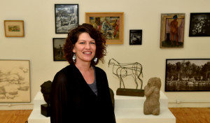 Shannon Haines, center, president and CEO of Waterville Creates!, poses for a portrait Wednesday at the Common Street Arts gallery at The Center in downtown Waterville.