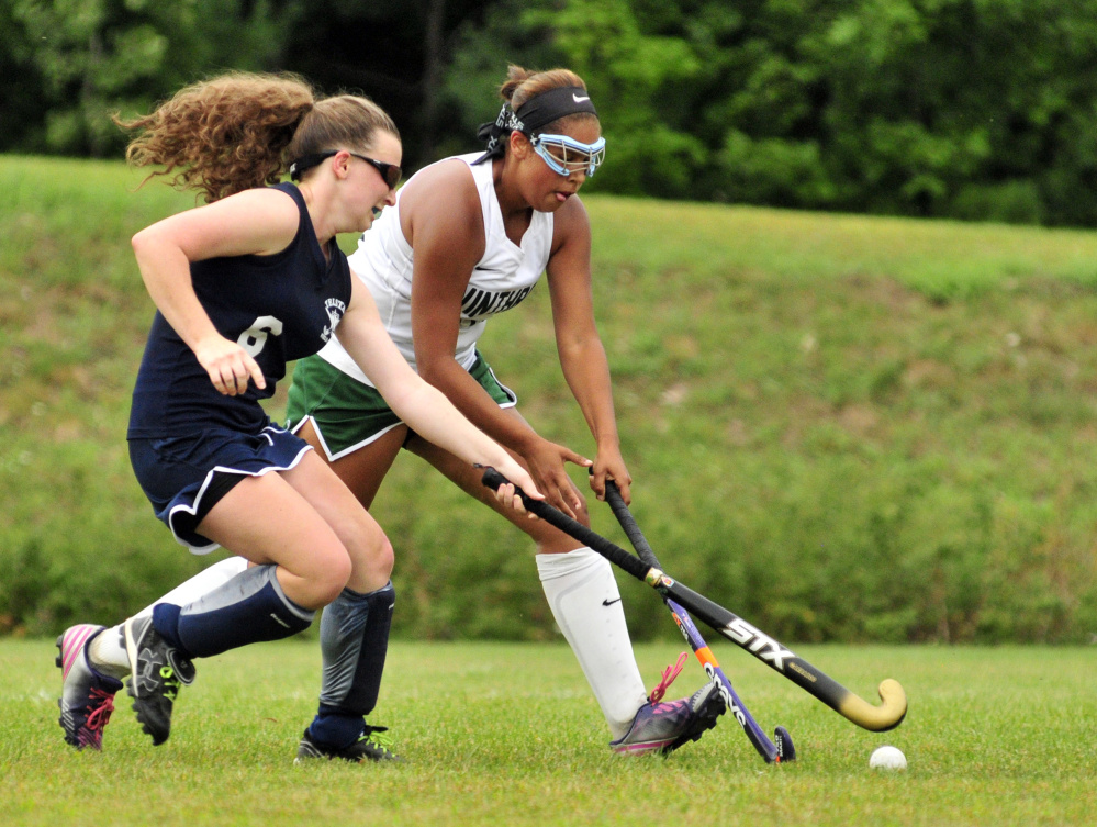 Telstar's Wynter Morin, left, tries to stop Winthrop sophomore Breonna Feeney during a season-opening game Wednesday at Winthrop High School. The Ramblers won, 9-0.