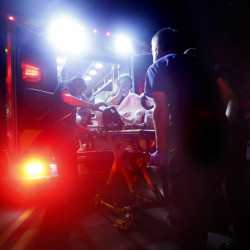Portland paramedics use the opioid overdose antidote naloxone to revive a woman last August. The price of naloxone has soared, with some versions now costing up to 17 times as much as they did two years ago.
