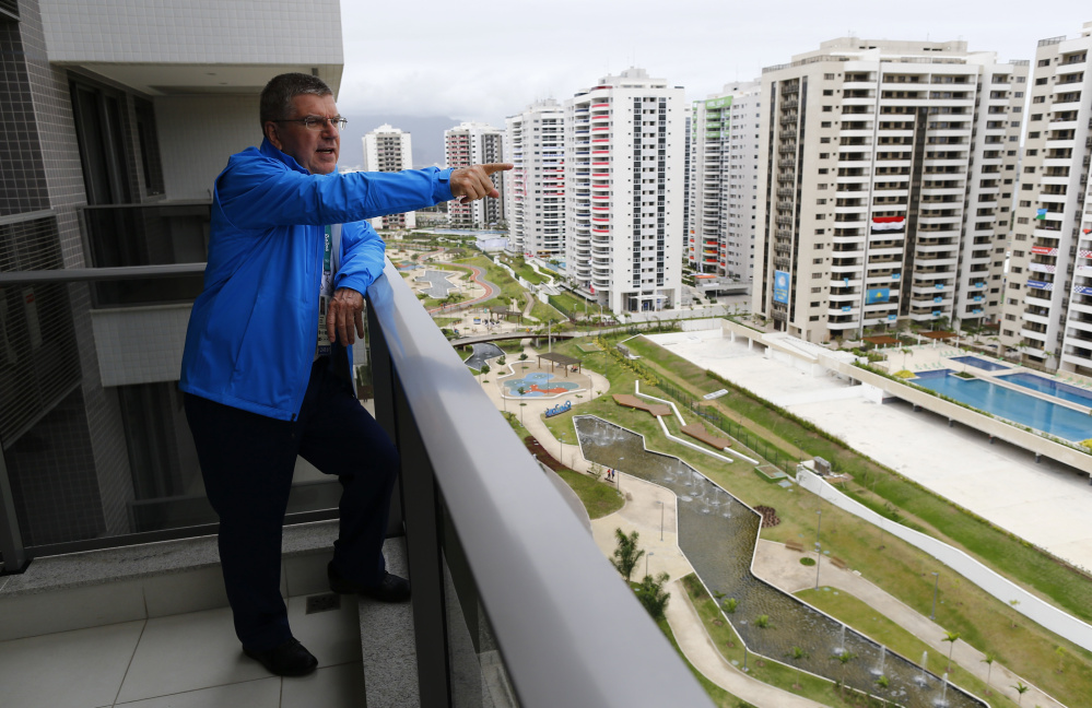Tomas Bach, President of the International Olympic Committee, looks out from his balcony after moving into his room in the Olympic village in Rio de Janeiro, Brazil, Thursday.  Ivan Alvarado/Pool Photo via AP