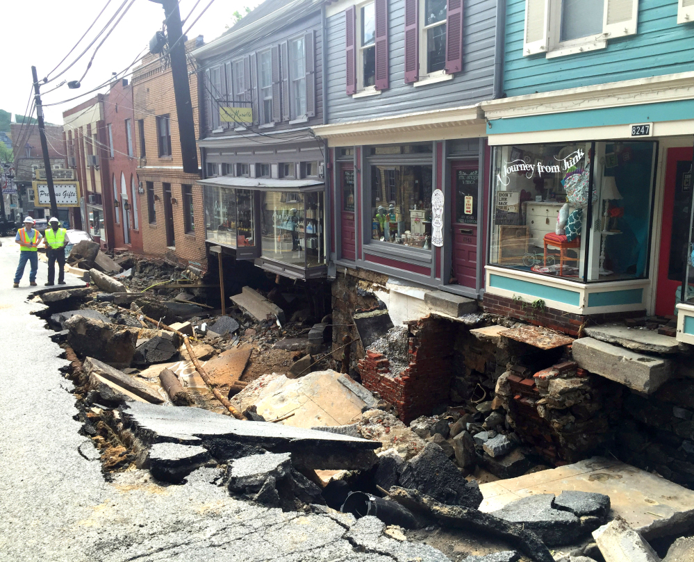 Low-lying Ellicott City, Maryland, was ravaged by floodwaters Saturday night, killing a man and a woman, and causing devastating damage to homes and businesses.