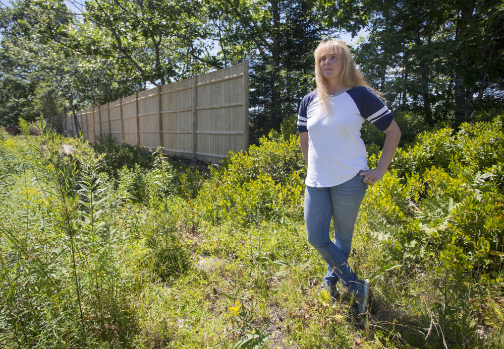 "The attorney for Rebecca Abbott, above, who runs Kick Start Stables with her husband, says Paul Coulombe built an illegal ""spite fence"" along the edge of his golf course."