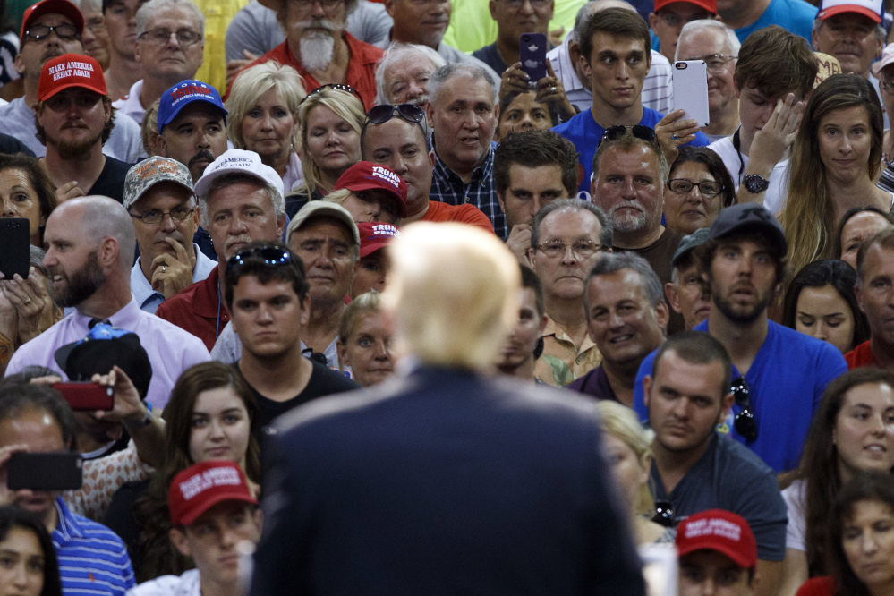 Donald Trump speaks Wednesday at a campaign stop in Daytona Beach, Fla. Meanwhile, Trump's running mate, Indiana Gov. Mike Pence, appeared to break from the candidate by endorsing House Speaker Paul Ryan in his Republican primary race. Trump has hinted that he may not support Ryan or Sen. John McCain, and has even complimented Ryan's opponent.