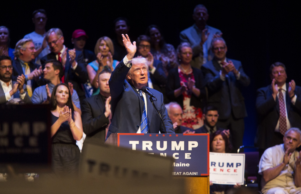 """Donald Trump acknowledges applause Thursday during his speech at Merrill Auditorium. On immigration, he said the refugees admitted by the U.S. are """"coming from among the most dangerous territories and countries anywhere in the world. This is a practice that has to stop."""""""