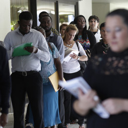 In this Tuesday, July 19, 2016, photo, people stand in line to apply for a job with Aldi at a job fair in Miami Lakes, Fla. On Thursday, Aug. 25, 2016, the Labor Department reports on the number of people who applied for unemployment benefits a week earlier. (AP Photo/Lynne Sladky)