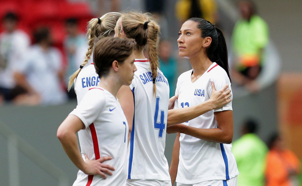 United States' Christen Press is comforted by a teammate after missing a penalty kick during a shoot-out against Sweden at a quarterfinal match of the women's Olympic football tournament in Brasilia on Friday. The United States was eliminated by Sweden.