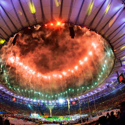 Pyrotechnics erupt during the Olympic closing ceremony in the Maracana stadium.