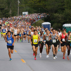 Runners leave the starting line at the beginning of the TD Beach to Beacon 10K road race in Cape Elizabeth on Saturday.