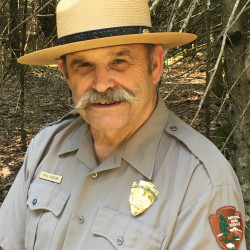 Tim Hudson, a longtime National Park Service facilities and park manager, will spearhead efforts at the newly created Katahdin Woods & Waters National Monument in Maine.