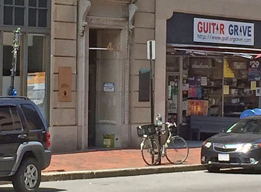 The package appears in the doorway of the building at 433 Congress St., which is shared by Planned Parenthood.
