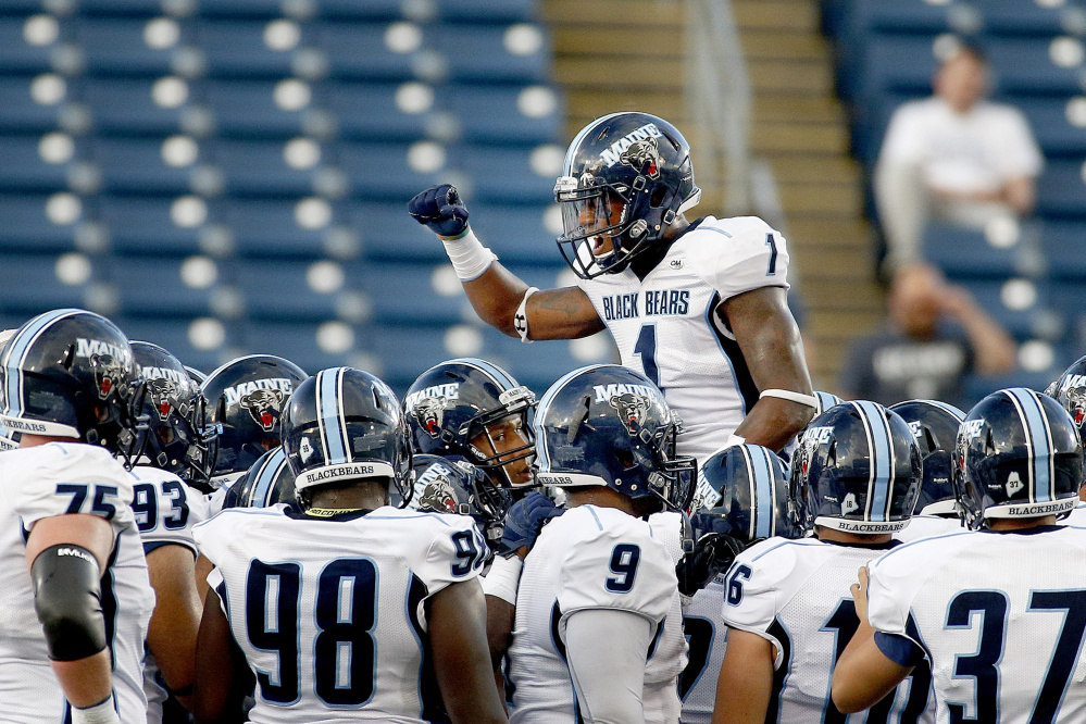 Najee Goode of UMaine fires up his teammates before they take on UConn in the season opener Thursday night at Rentschler Field in East Hartford, Conn.