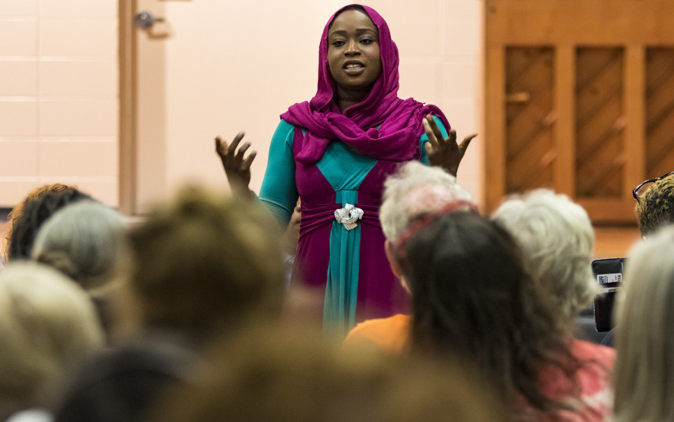 """Ekhlas Ahmed, a panelist at the forum Thursday night, said she left Sudan because of racism and """"came here thinking it would be a different life, but it's not."""""""
